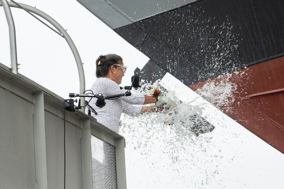 Ship Sponsor Polly Spencer Breaks A Bottle Of Sparkling Wine Across The Bow During The Christening Ceremony For The Nation's 27th Littoral Combat Ship, The Future USS Nantucket.
