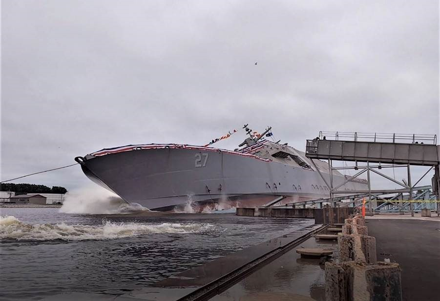 The 27th Littoral Combat Ship, the future USS Nantucket, launches sideways into the Menominee River in Marinette, Wisconsin, on August 7.