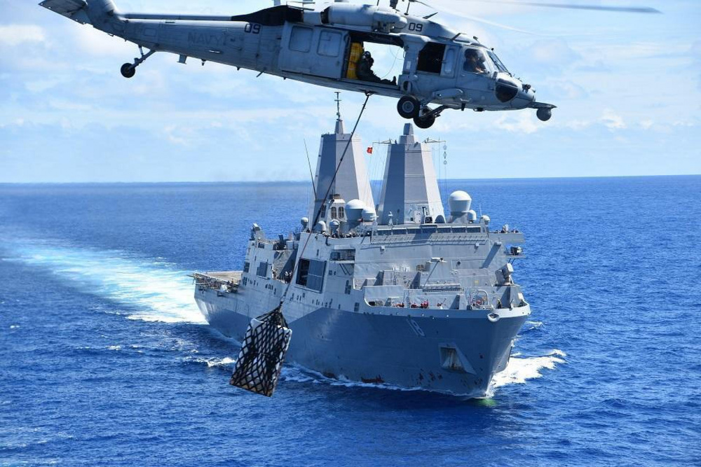 The San Antonio-class amphibious transport dock ship USS New Orleans (LPD 18) conducts an underway replenishment with USNS Matthew Perry (T-AKE 9) in the Pacific Ocean, Aug. 5, during Large Scale Exercise.