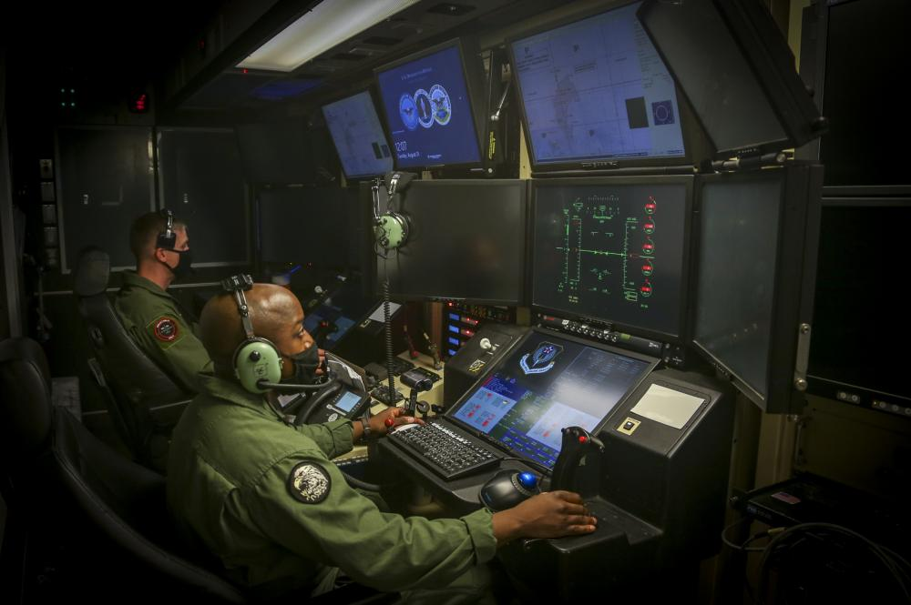 U.S. Marine Corps Captain Joshua Brooks and Master Sergeant Willie Cheeseboro Jr., an enlisted aircrew coordinator with Marine Unmanned Aerial Vehicle Squadron (VMU) 1, prepare to launch and operate the first Marine Corps owned MQ-9A Reaper on Marine Corps Air Station Yuma, Ariz. August 30, 2021.