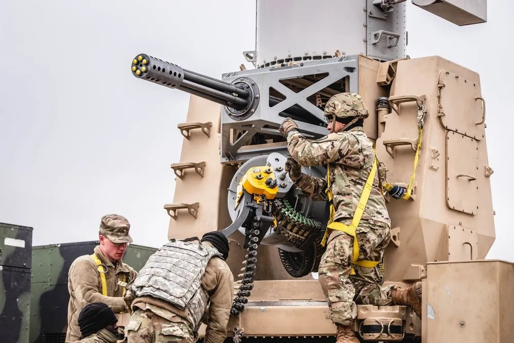 Members of Bravo Battery, 5th Battalion, 5th Air Defense Artillery Regiment, load a counter rocket, artillery, and mortar system Feb. 20 2020, during a platoon-level field training exercise on Fort Sill, Okla.
