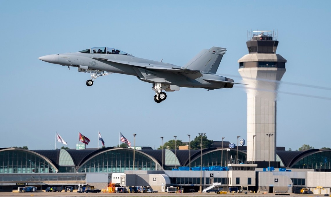 The first operational Block III F/A-18 Super Hornet lifts off over Lambert International Airport in St. Louis. (Photo by Boeing)