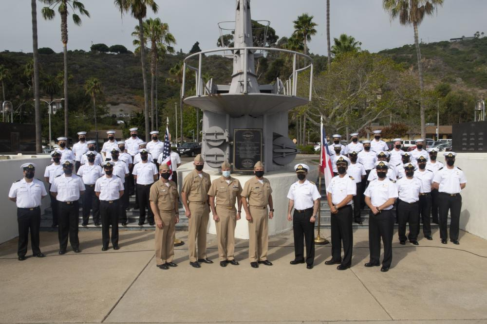 U.S. Navy Sailors and Sailors from the Armada de Chile pose for a photo following a ceremony hosted by Commander, Submarine Squadron 11 (CSS-11) in recognition of the conclusion of the 2021 Diesel-Electric Submarine Initiative (DESI) program with the Chilean scorpène-class CS Carrera (SS-22) on Naval Base Point Loma, Sept. 14.