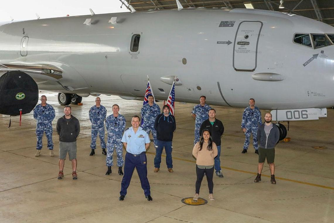 Officer Commanding No. 92 Wing, Group Captain John Grime, front centre, stands with staff and personnel from Surveillance and Response Systems Program Office, No. 92 Wing and Boeing in front of P-8A Poseidon A47-006. Photo: Corporal Brenton Kwaterski