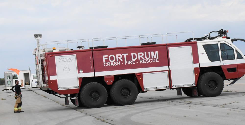 A fire crew from Fort Drum Directorate of Fire and Emergency Services' Station 3 supports the hot refuel operation Sept. 21 at Wheeler-Sack Army Airfield.