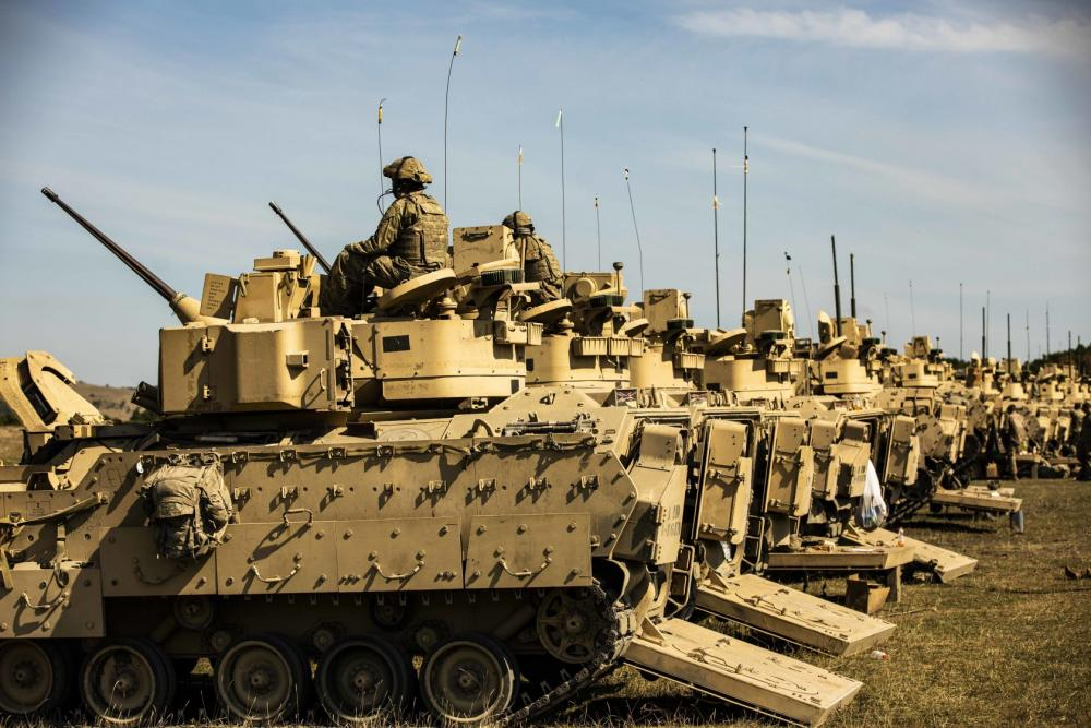 """U.S. Army Soldiers assigned to Alpha Company, 1st Battalion, 16th Infantry Regiment """"Iron Rangers,"""" 1st Armored Brigade Combat Team, 1st Infantry Division prepare to conduct the Table V live-fire iteration for their Bradley Fighting Vehicle crew gunnery training at Land Forces Combat Training Center Getica in Cincu, Romania, Sept. 13, 2021."""