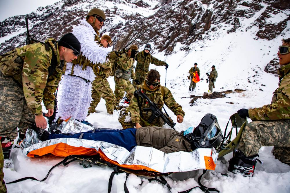 U.S. Army Soldiers assigned to Bravo Company, 2nd Battalion, 87th Infantry Regiment, 2nd Brigade Combat Team, 10th Mountain Division, and Chilean army soldiers assigned to 3rd Mountain Division, conduct a mock-rescue operation in Portillo, Chile Aug. 27, 2021.