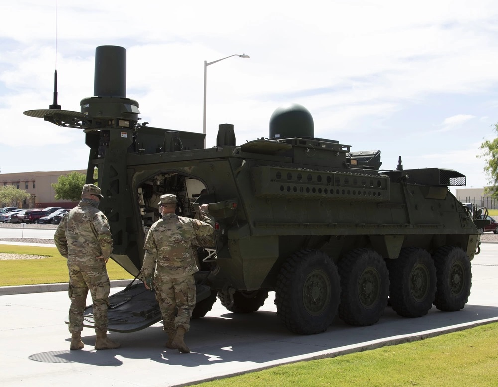 1st Armored Division Electronic Warfare specialist take a look at the Army's newest EW system, the Stryker-mounted Tactical Electronic Warfare System (TEWS), an integrated platform. 1AD is the first division in III Corps to overhaul its EW capabilities as a part of the Army's campaign to modernize its force for 21st-century conflict.