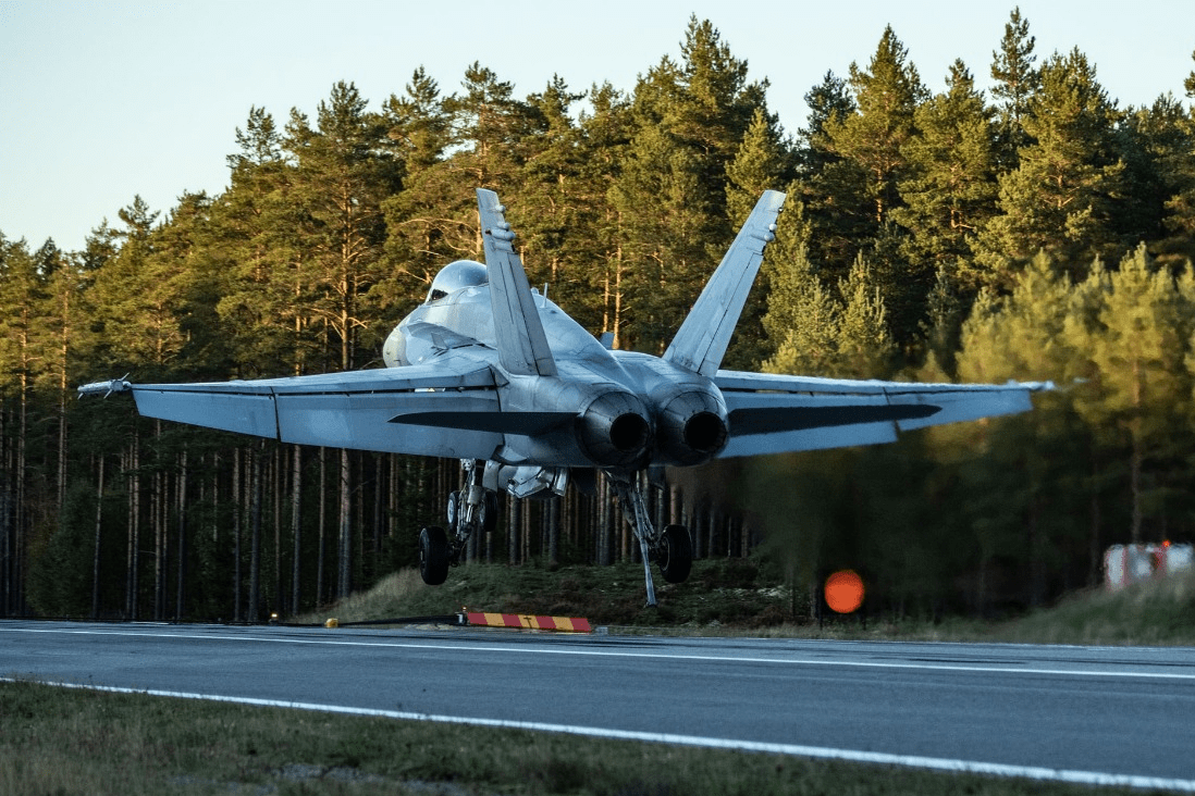 A Finnish F/A-18 fighter jet during landing on a highway in a previous exercise. Archive photo by Finnish Air Force.