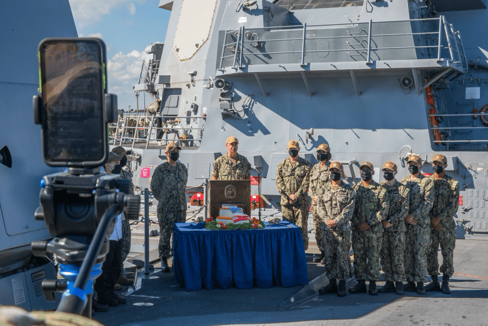Rear Adm. Brendan McLane, commander, Naval Surface Force Atlantic, introduces the Task Group Greyhound (TGG) Initiative during a livestream aboard the guided-missile destroyer USS Thomas Hudner (DDG 116).