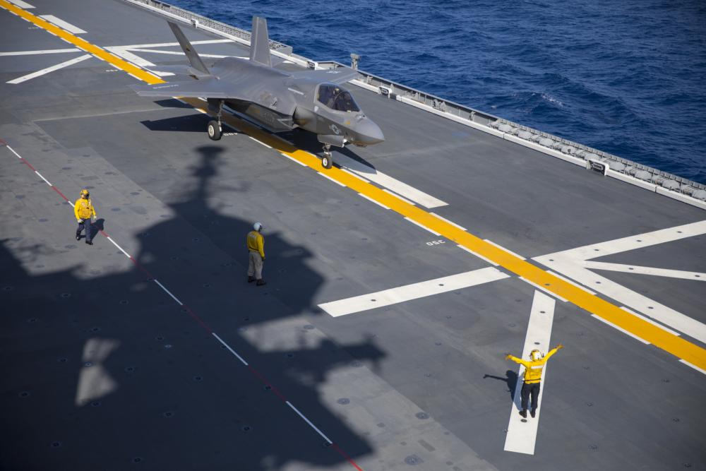 U.S. Sailors direct a Marine Corps F-35B Lightning II aircraft with Marine Fighter Attack Squadron (VMFA) 242 aboard the Japanese Ship Izumo off the coast of Japan, Oct. 3, 2021.