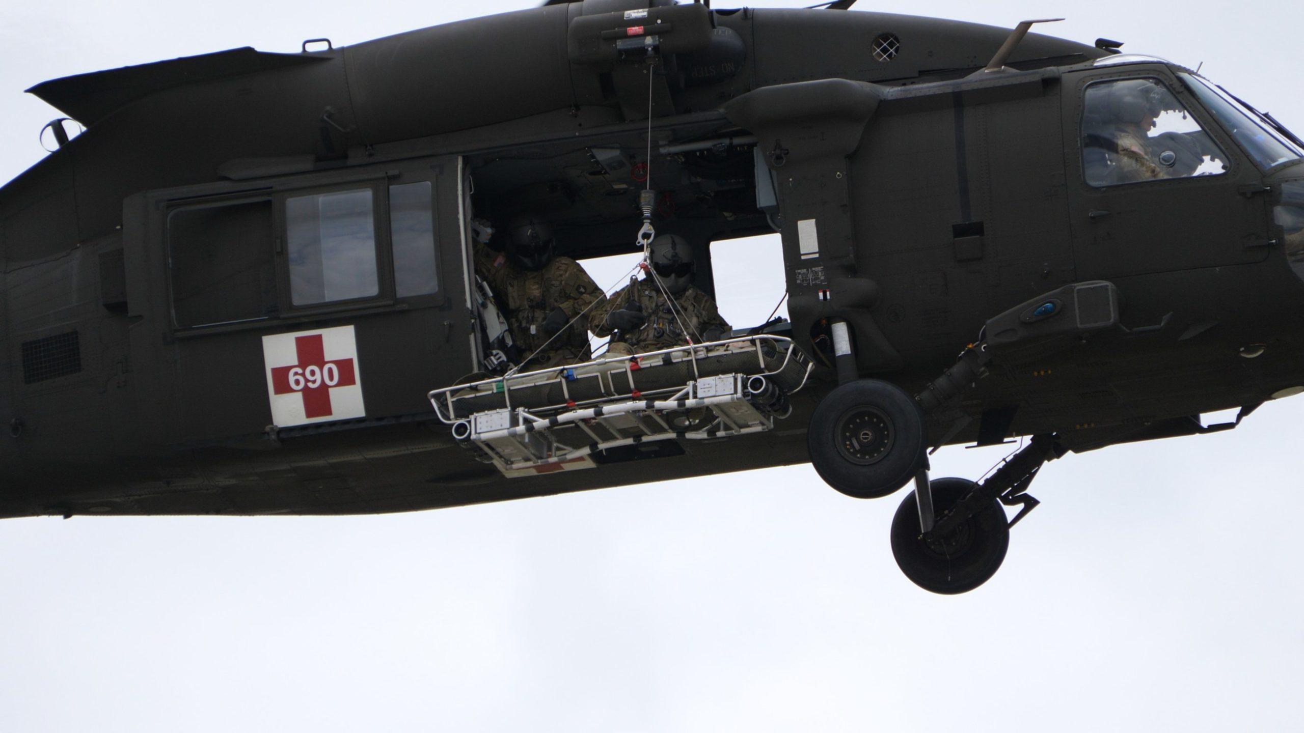 The Vita Rescue System Litter Attachment Under a Black Hawk Helicopter