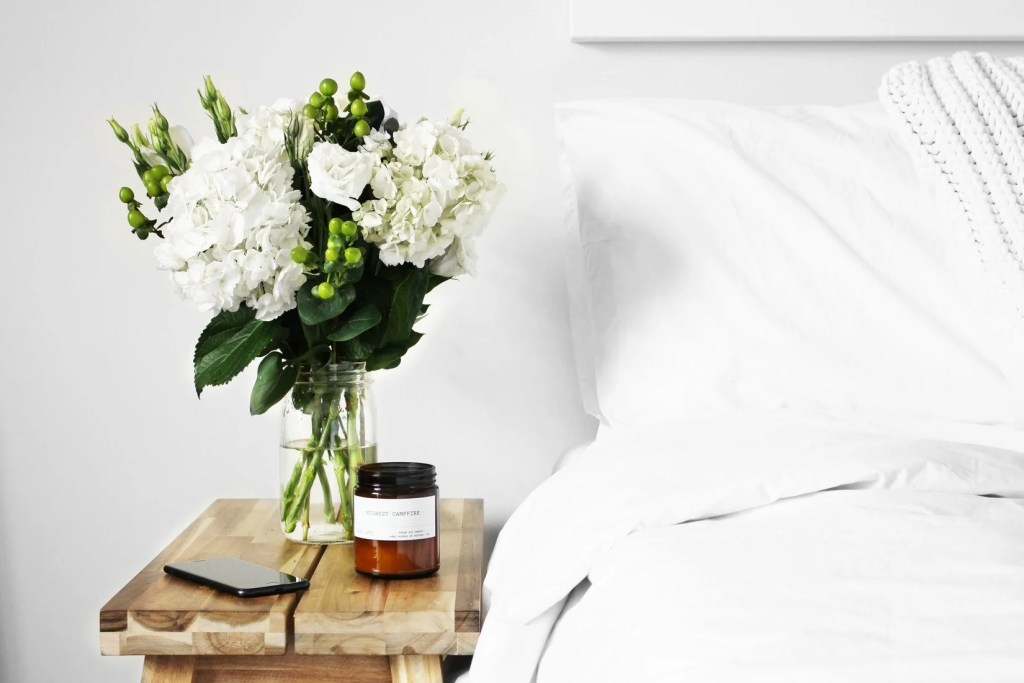 guest room bedside table with flowers