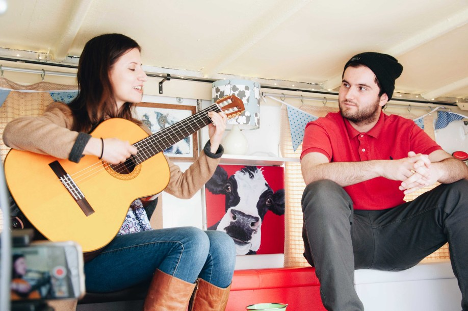 MA Songwriting student Andy listens to Alejandra playing in the 'festival lounge' setting of the Milk Float Stage