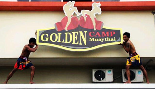 golden camp muay thai fighters and sign