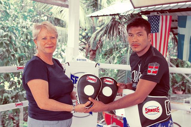 Sandee-Muay-Thai-Gear-presented-to-trainer