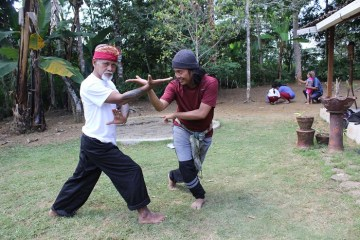 2 silat instructors teaching technique