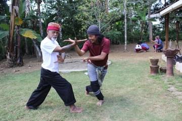 2 silat instructors teaching technique