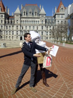 Brenden and Creamy, the Milk Not Jails mascot, delivering our Policy Agenda to Albany legislators.