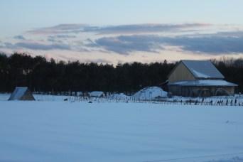 The farm under snow at dusk