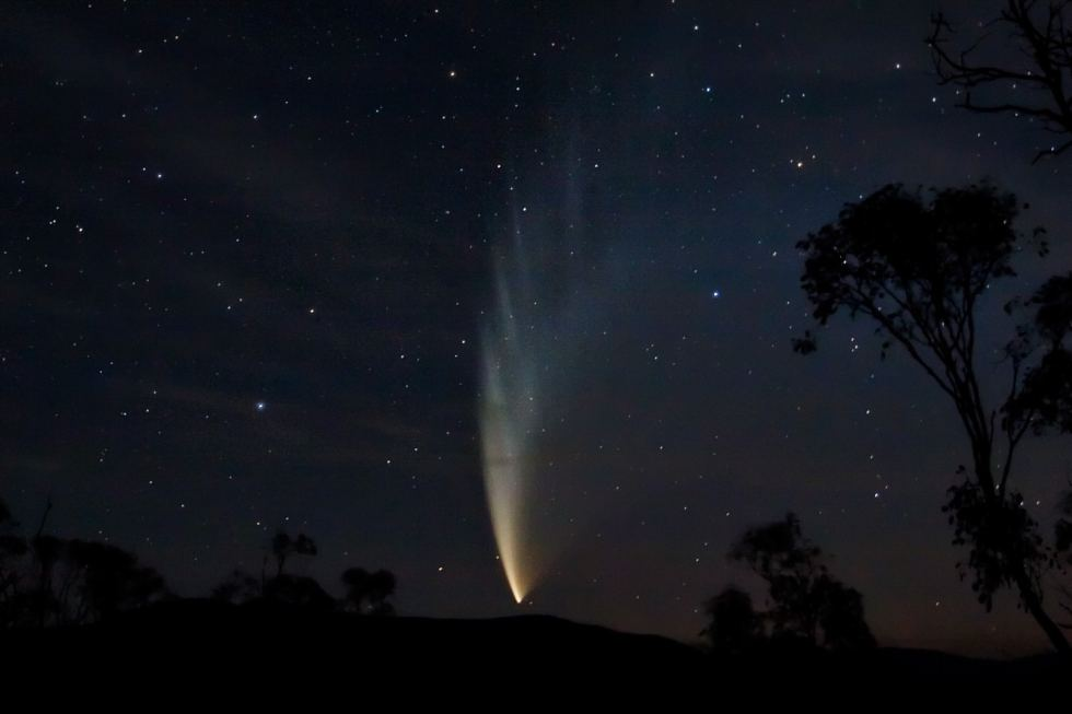 Comet C/2006 P1 McNaught; photo taken from Swifts Creek, Victoria, Australia at approx. 10:10PM. Taken at f/4, ISO 800, 20 seconds and ~24 mm with post-processing in Photoshop to bring out details