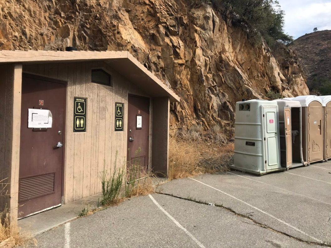 Closed Outhouses replaced with Port-a-potties.
