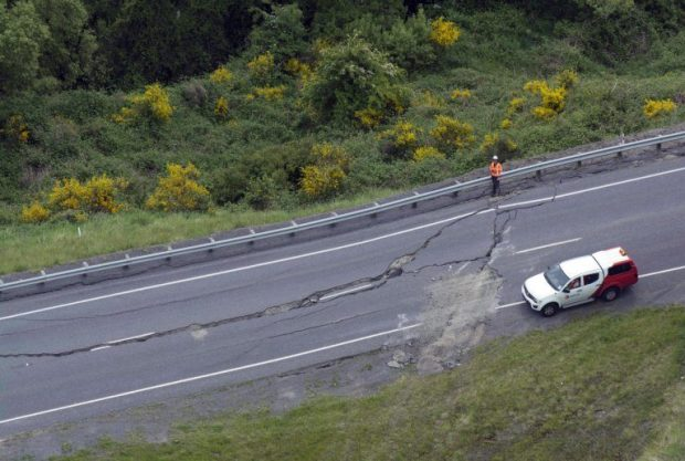 The aerial photo shows cracks on a state highway near Kaikoura, New Zealand after a powerful earthquake Monday, Nov. 14, 2016. A powerful earthquake that rocked New Zealand on Monday triggered landslides and a small tsunami, cracked apart roads and homes, but largely spared the country the devastation it saw five years ago when a deadly earthquake struck the same region. (David Alexander/SNPA via AP)