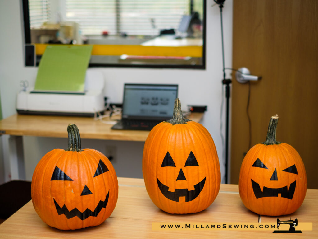 Some Quick Vinyl Work on the Cricut is all it took to transform our Pumpkins to a team of Jack-O-Lanterns