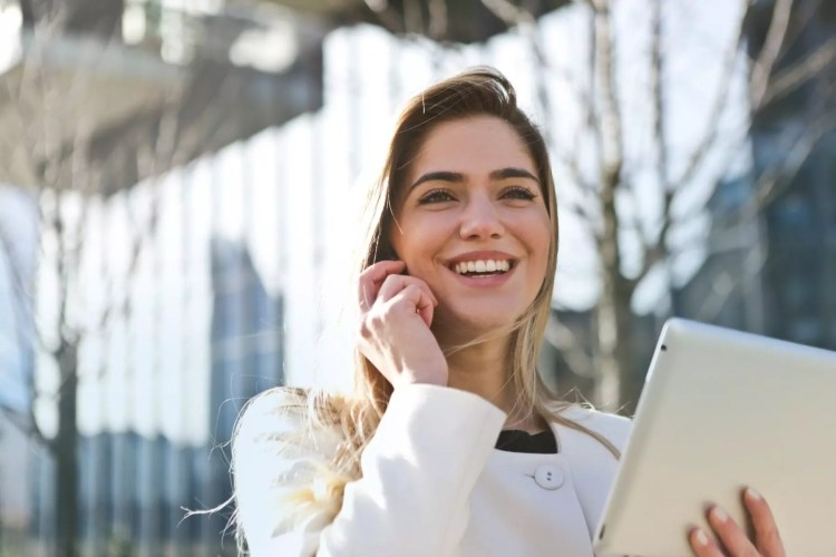 Earn respect as a young professional. Young professional smiling on phone call
