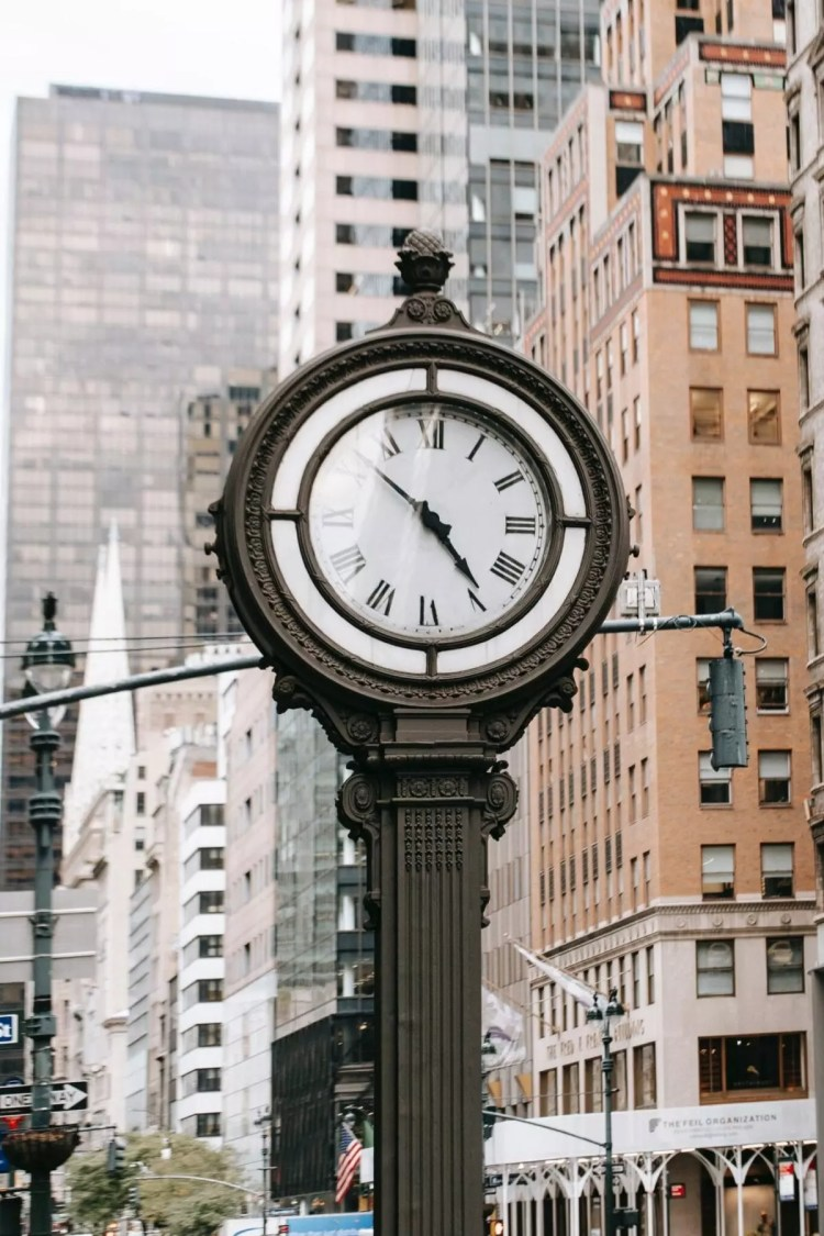 Vintage clock in city on street