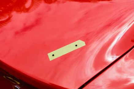 Here are the drilled holes for the Genesis Coupe rear spoiler.