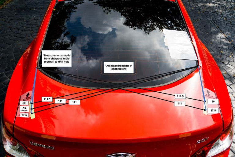 Measurement of the spoiler drill locations for a 2010 Hyundai Genesis Coupe.