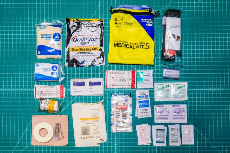 This is the vast majority of my motorcycle First Aid Kit Components. The tourniquet aside, it all fits in the yellow bag.