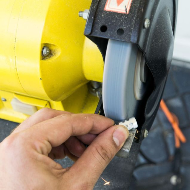 Use a bench grinder to make indents on the coupler nuts.