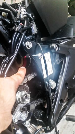 On this 2016 Kawasaki Ninja 650, the siren was installed in the crevice above the sprocket. The siren's wiring isn't connected to anything yet.