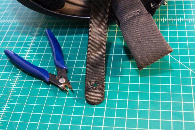 Remove the snap or cut the webbing to be able to slide on the triglide as well as one half of the buckle.