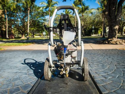 For a gas-powered pressure washer, you're going to need to secure it to the machine or have an assistant hold it for you.