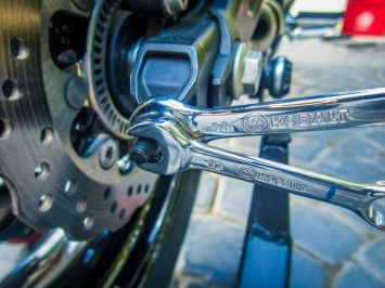 Similar to the chain tension, adjust the nuts on the right side of the swingarm to change the rear tire alignment until the sprocket is aligned with the chain.
