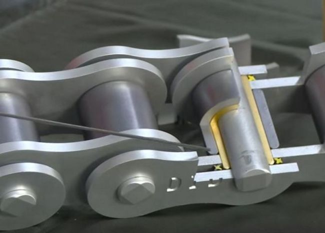 """This cylinder, called the """"Roller"""", rolls at it moves along the sprocket. This really helps to minimize wear. Given how it's always rolling that's why lubing the """"inside"""" or """"outside"""" of the chain doesn't matter."""