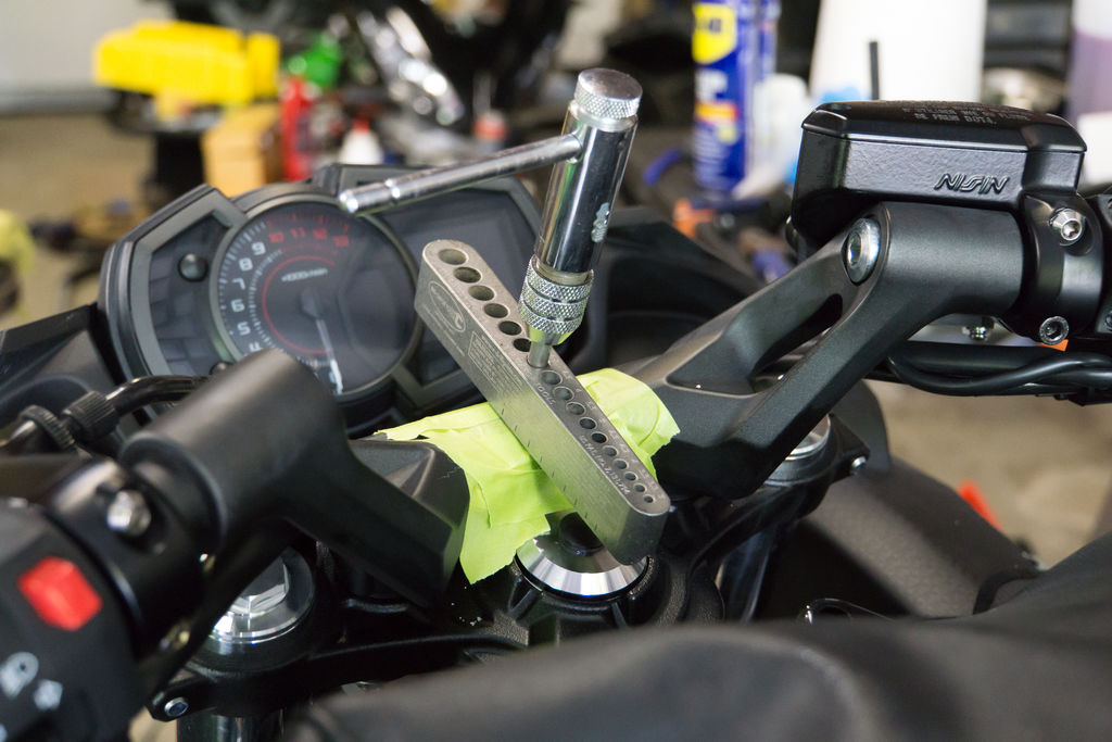 Tapping the hole for the motorcycle Ram Mount phone holder.