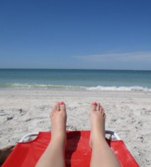 pregnant me with my pregnant feet at the beach. 20 days pre-baby