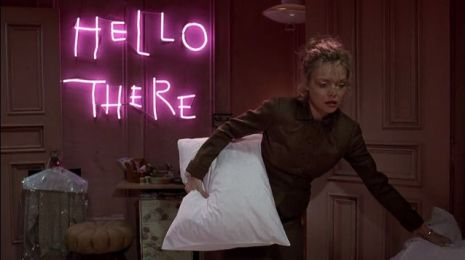 Hello_There Neon Sign in Catwoman's Apartment