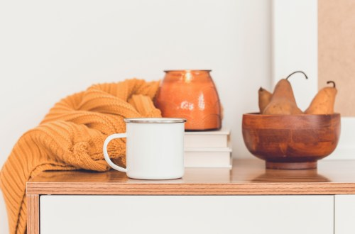 Autumn scene with coffee mug and candle
