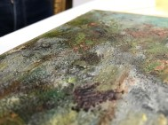 When the painting was given a wax reline, that heat affected the front by flattening some of the paint surface. There should be much more texture in this area.