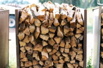 firewood pile at Tree Care by Robert Miller