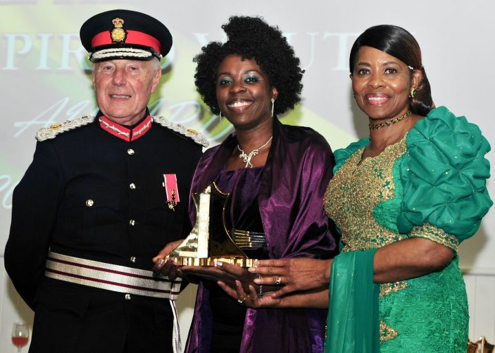 Millicent (middle) receiving the AJN Chairman's special award from the Lord- Lieutenant of the West Midlands John Crabtree, OBE and Vice Lord-Lieutenant Dr Beverly Lindsay OBE OD.