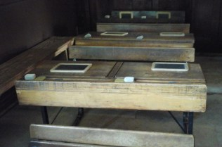 Row of Double Desks in Victorian Classroom