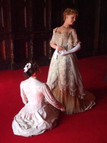 Maid assisting Daisy to dress