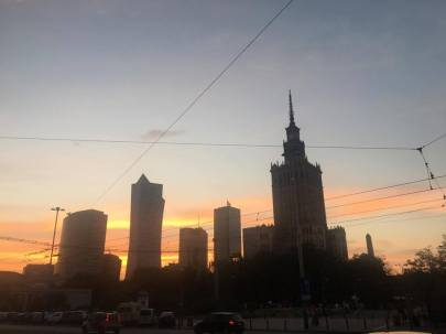 Warsaw skyscrapers silhouetted against the sunset