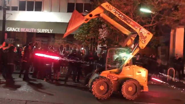 VIDEO: Protesters Steal Bulldozer and New Cars Off Showroom Floor During Oakland Riots